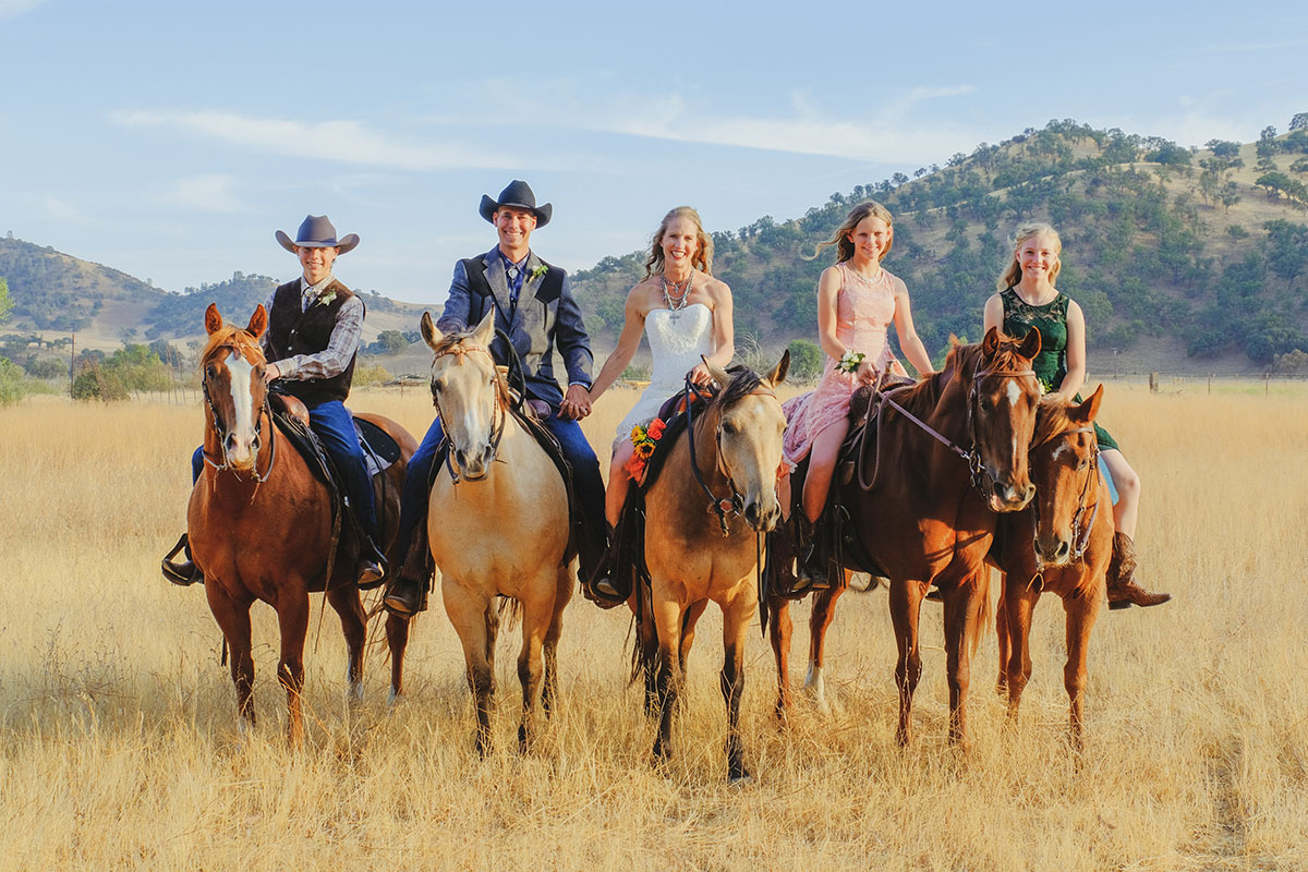 A photo of the Borland family, owners of the Bar SZ Ranch, located just east of Pinnacles National Park in California. They're all sitting on horses.