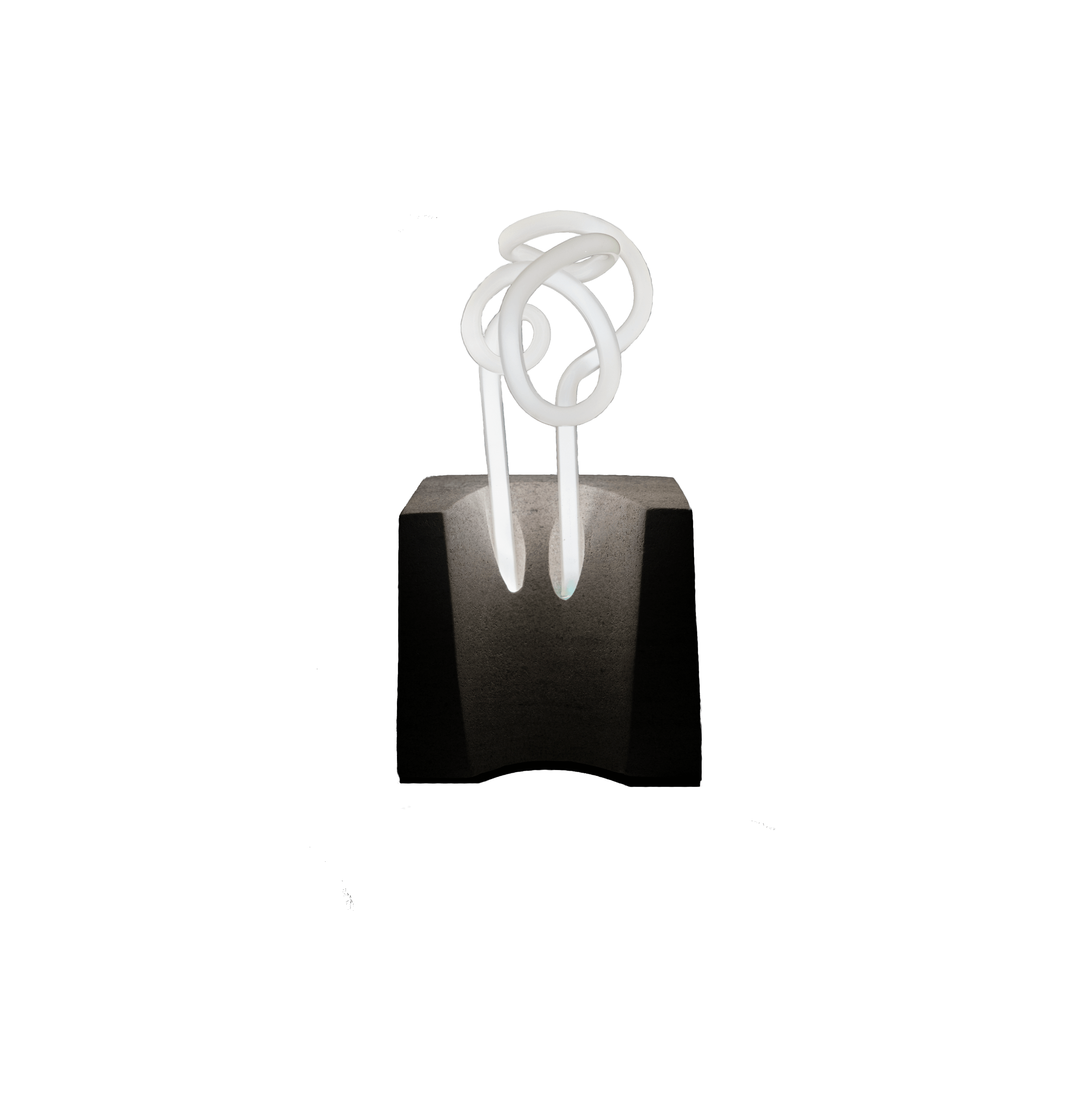 A squiggle of white neon bulb floats above a concave limestone base