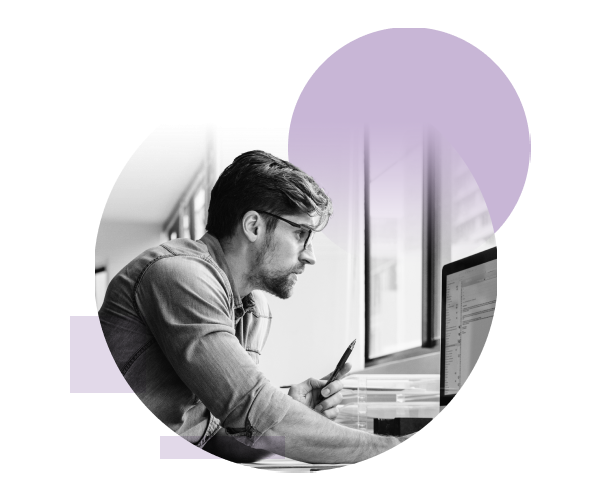 A male IT professional studying information on a screen