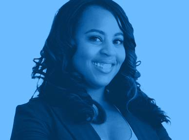 An image of a woman of color, looking confident. The image is tinted blue.