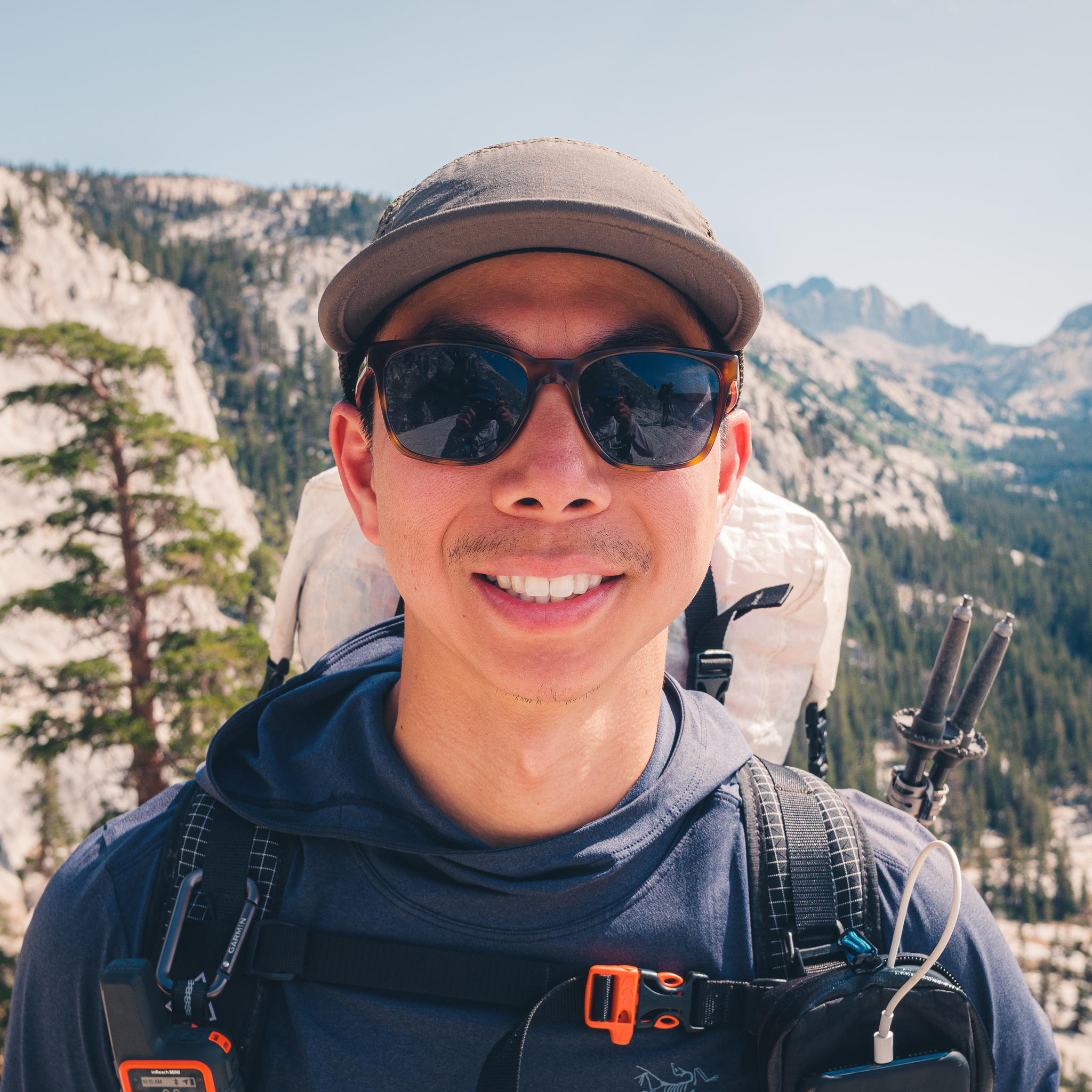 Portrait of Daniel Wong with a backpack hiking on the John Muir Trail