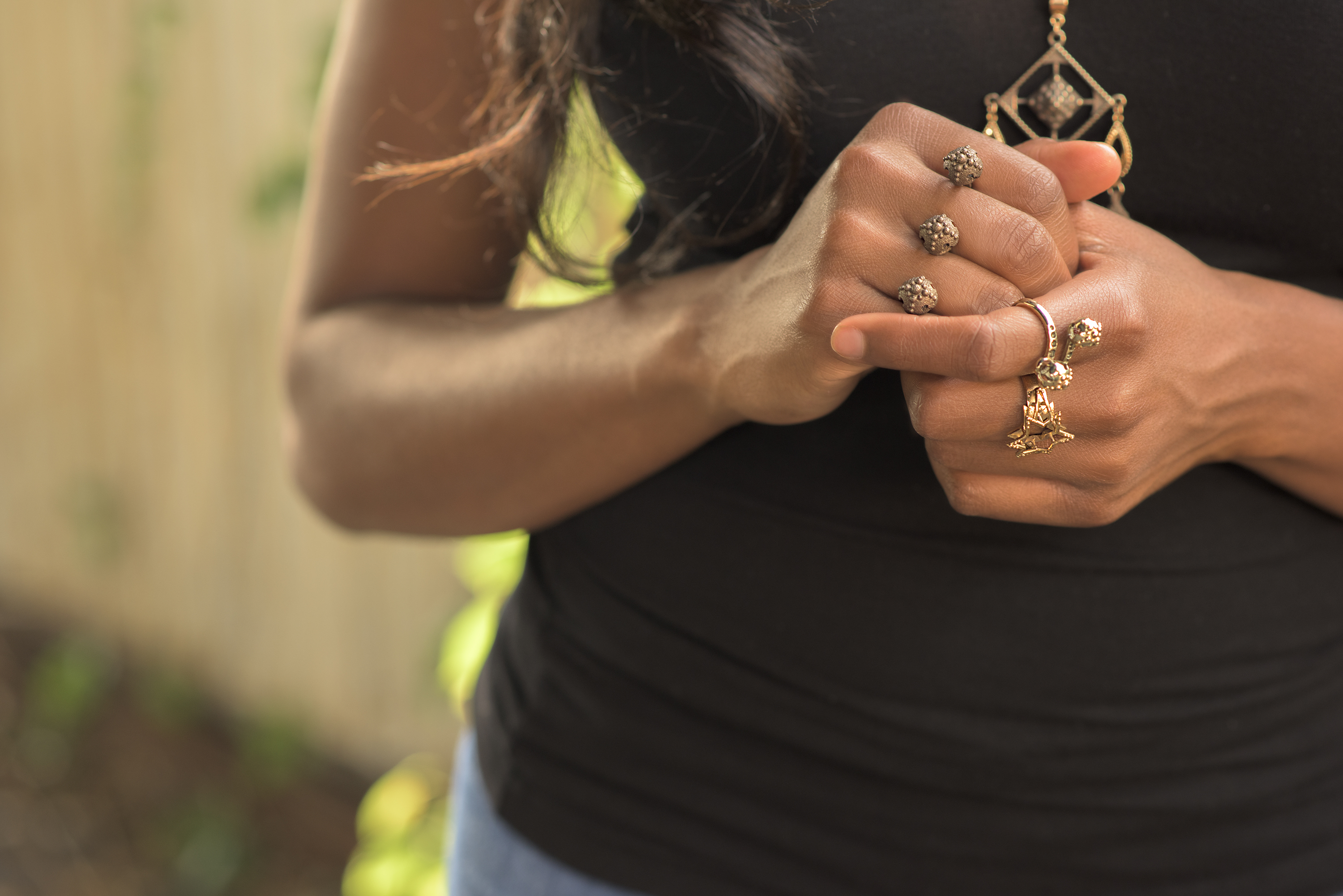 Falkora jewelry displayed on a model's hands