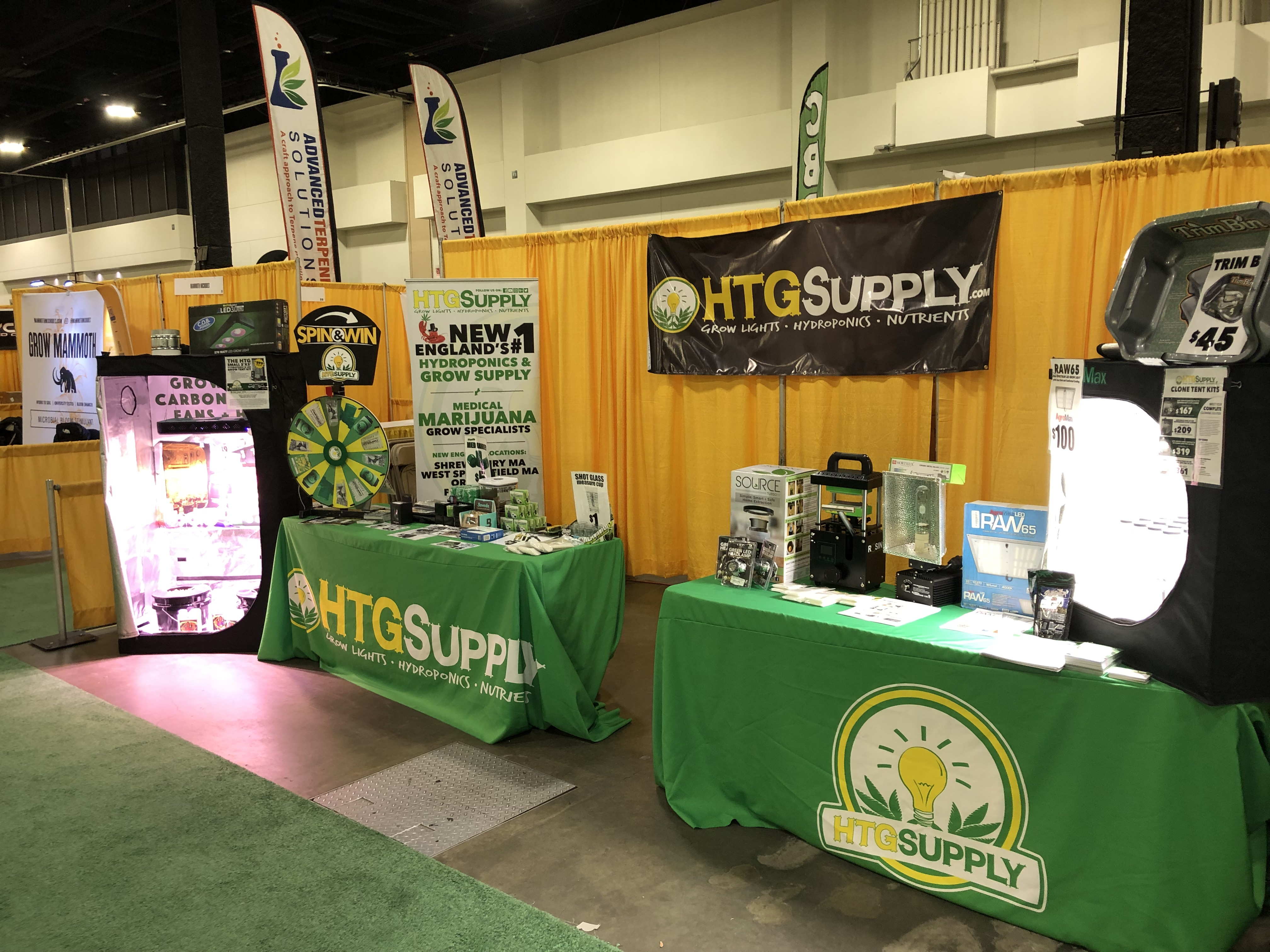 An HTG Supply booth at a convention.