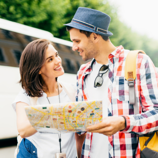 Young family tourists looking attentively in map