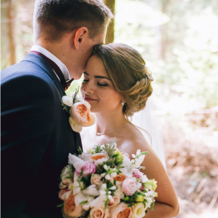 Bride and groom with flower