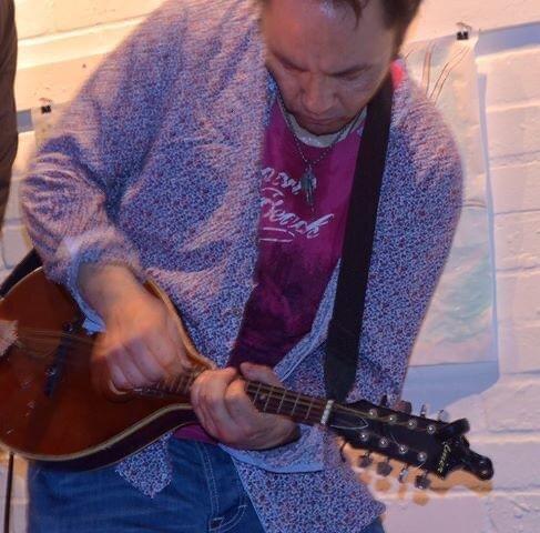 Daniel rocking out on his guitar. Photo courtesy of Daniel York Loh.