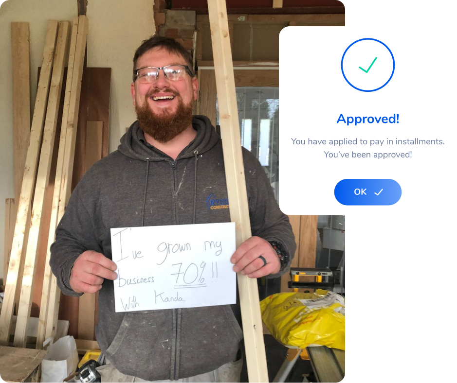 A tradesperson holding a sign showing they have won 30% more work