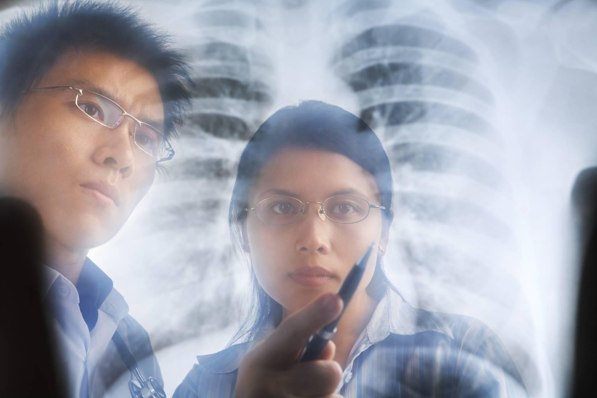 Two young medics looking at radiographs