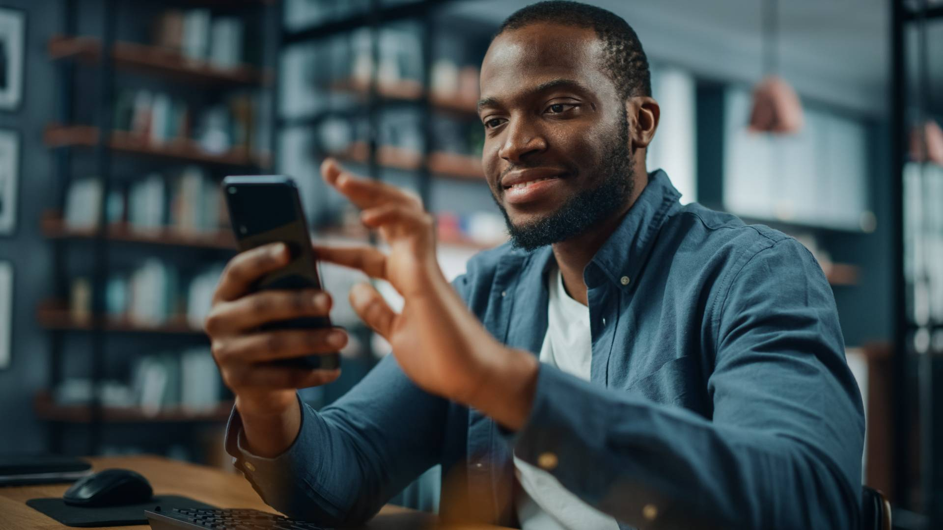 Man completing education from his phone