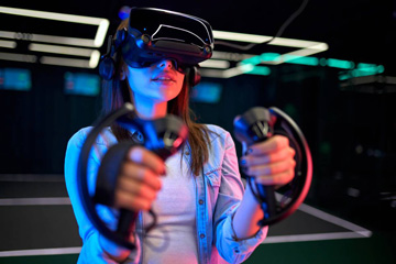 Young woman in VR headset with controllers
