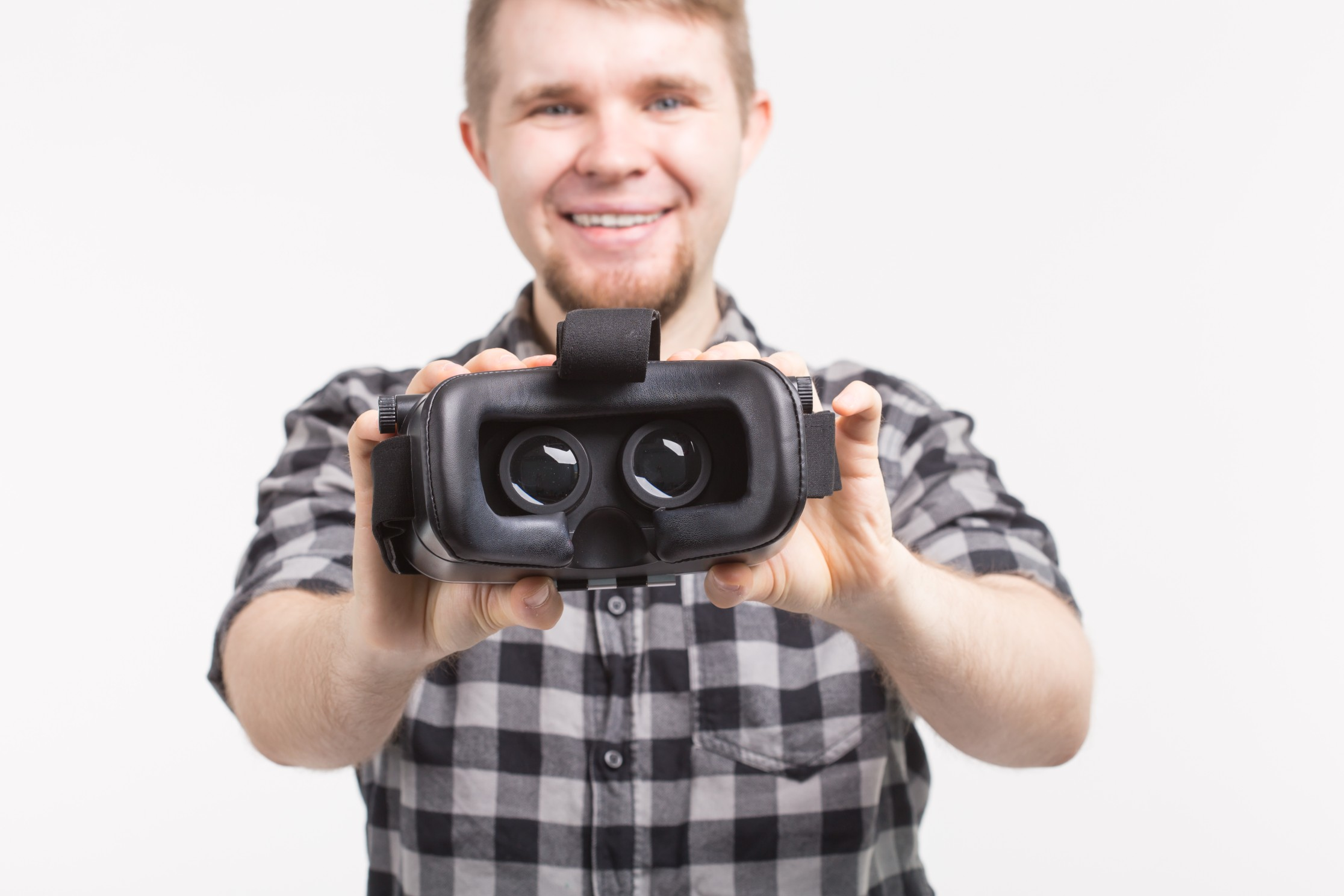 Instructor helps student put on a VR headset