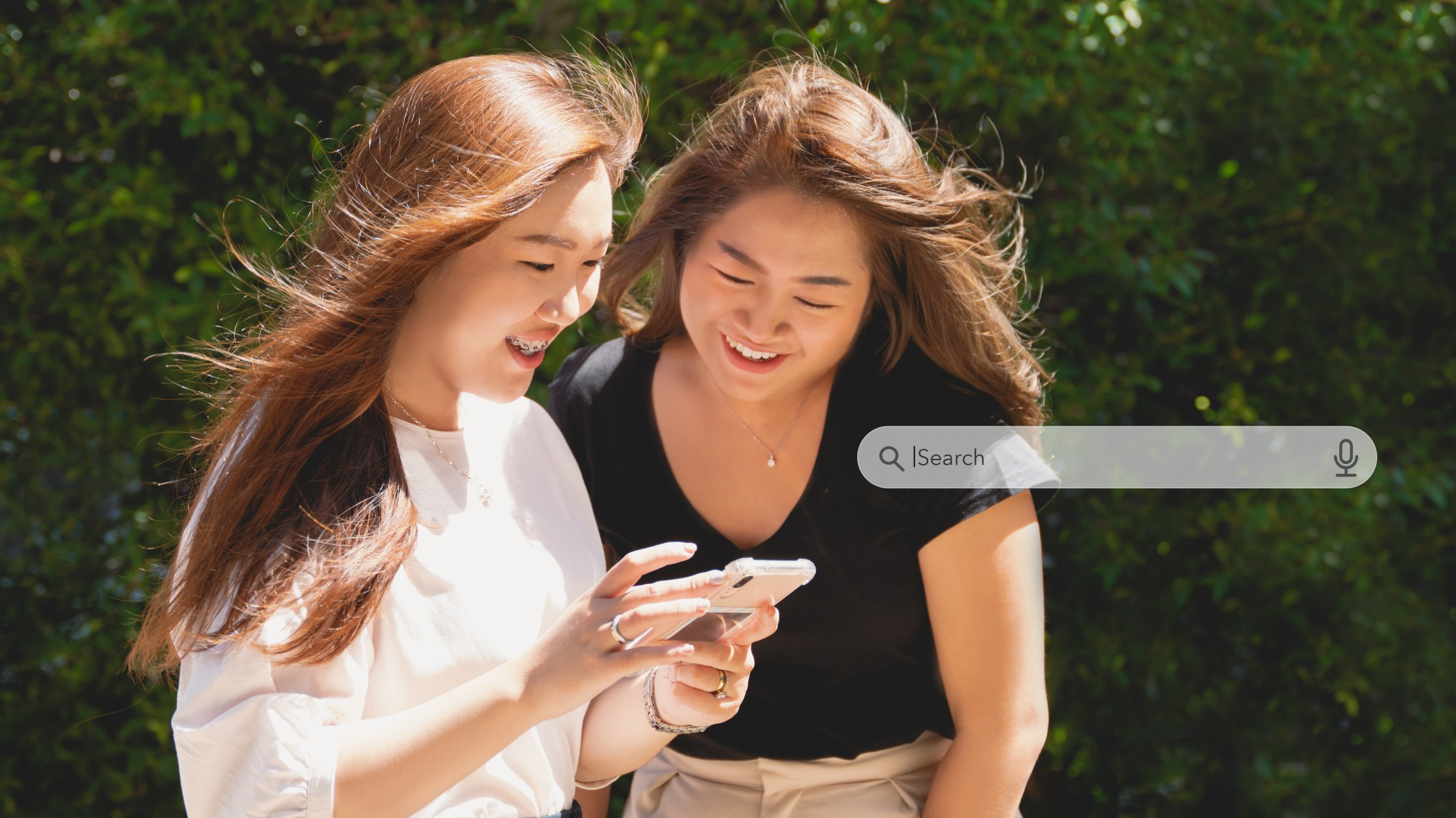 girls using a smartphone for learning