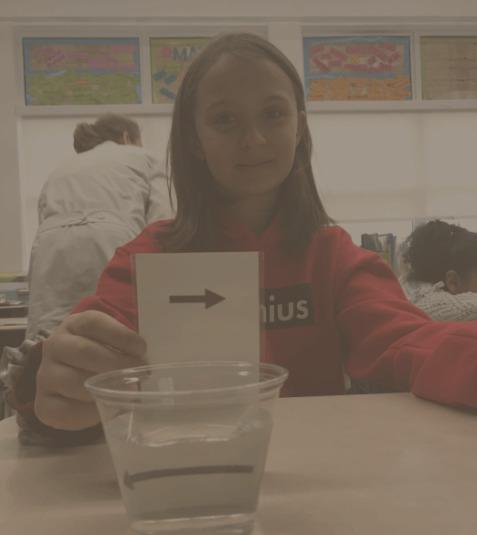 girl doing experiment with water