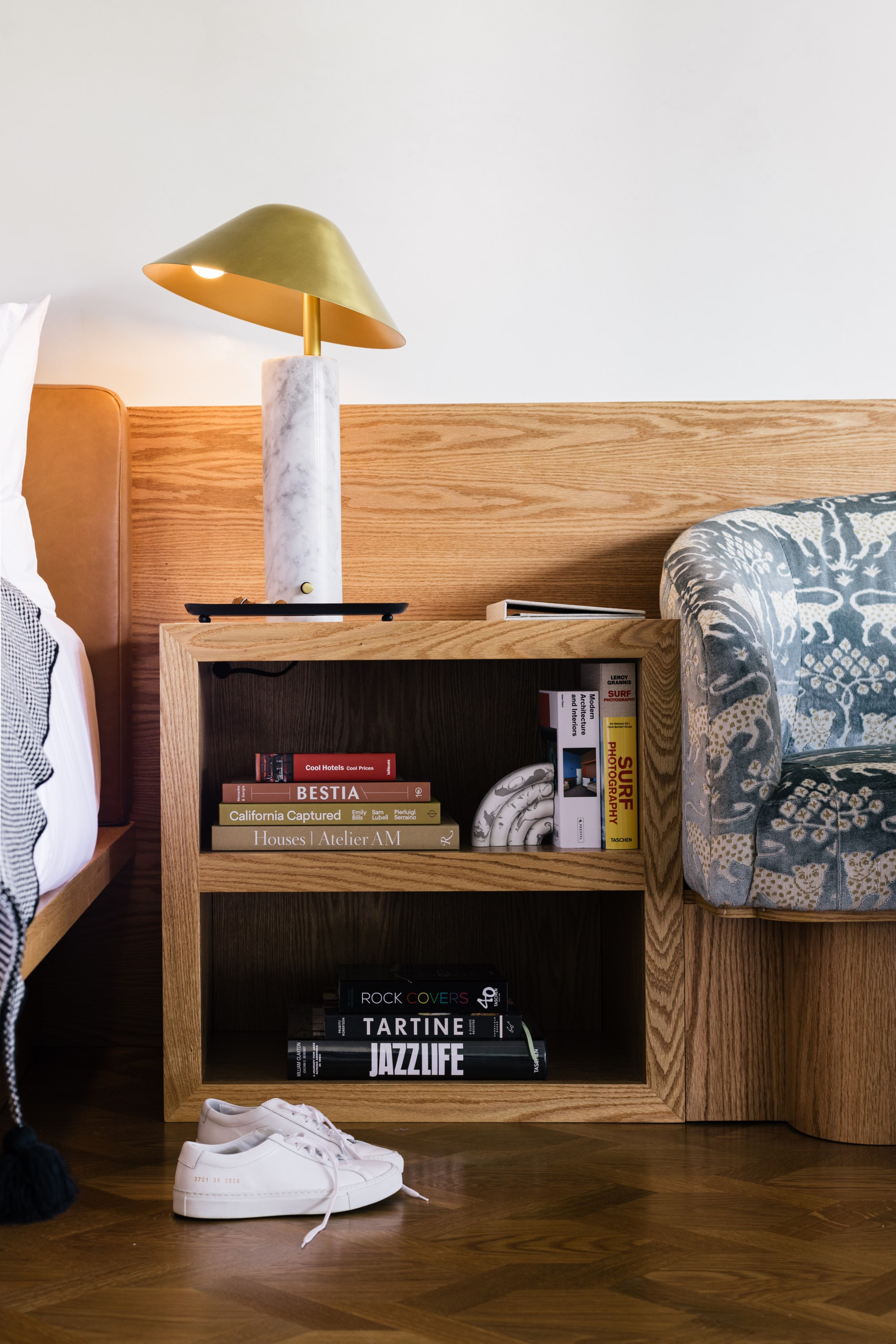 Bedside table with books and lamp