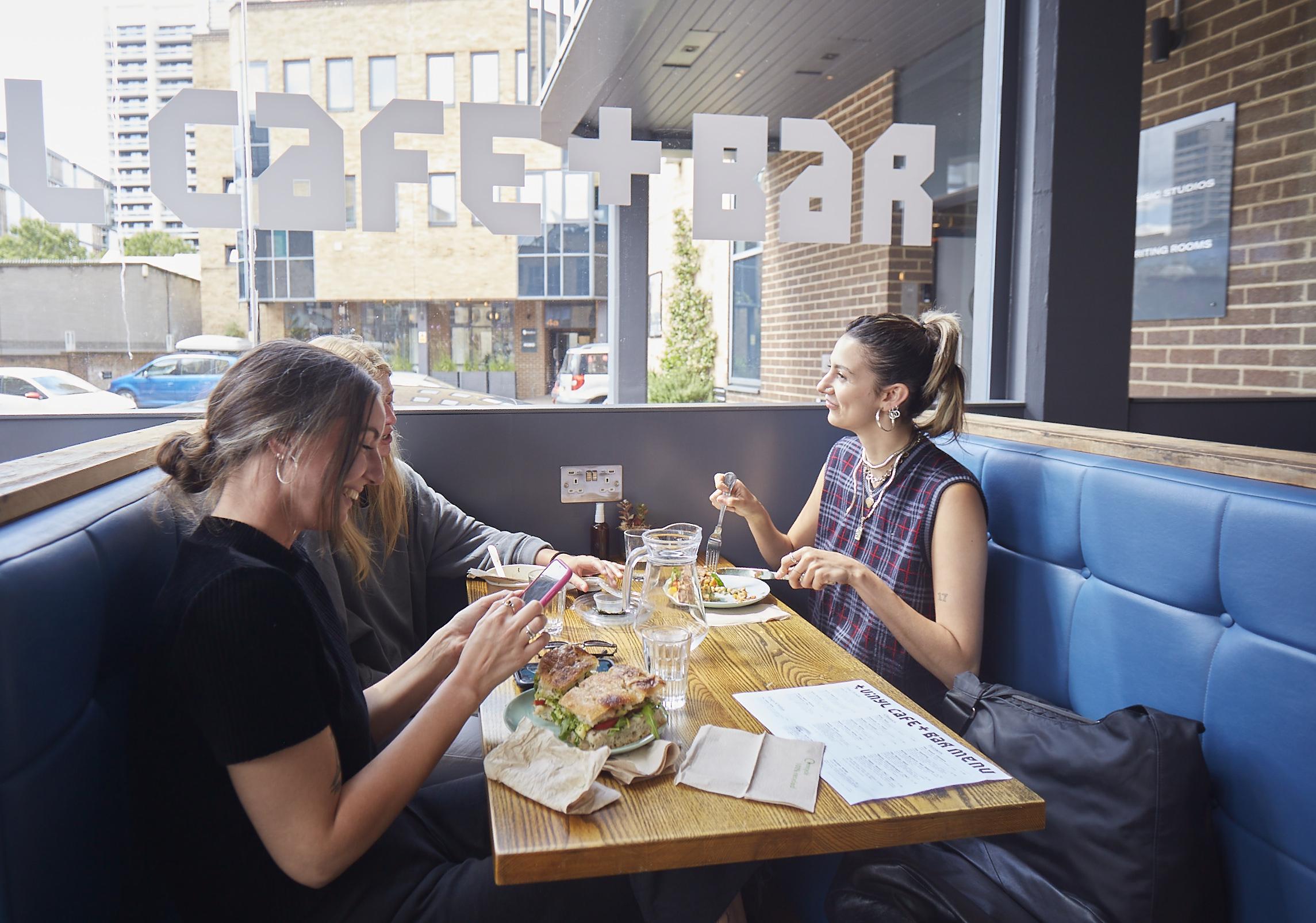 Three women eating at Vinyl Cafe