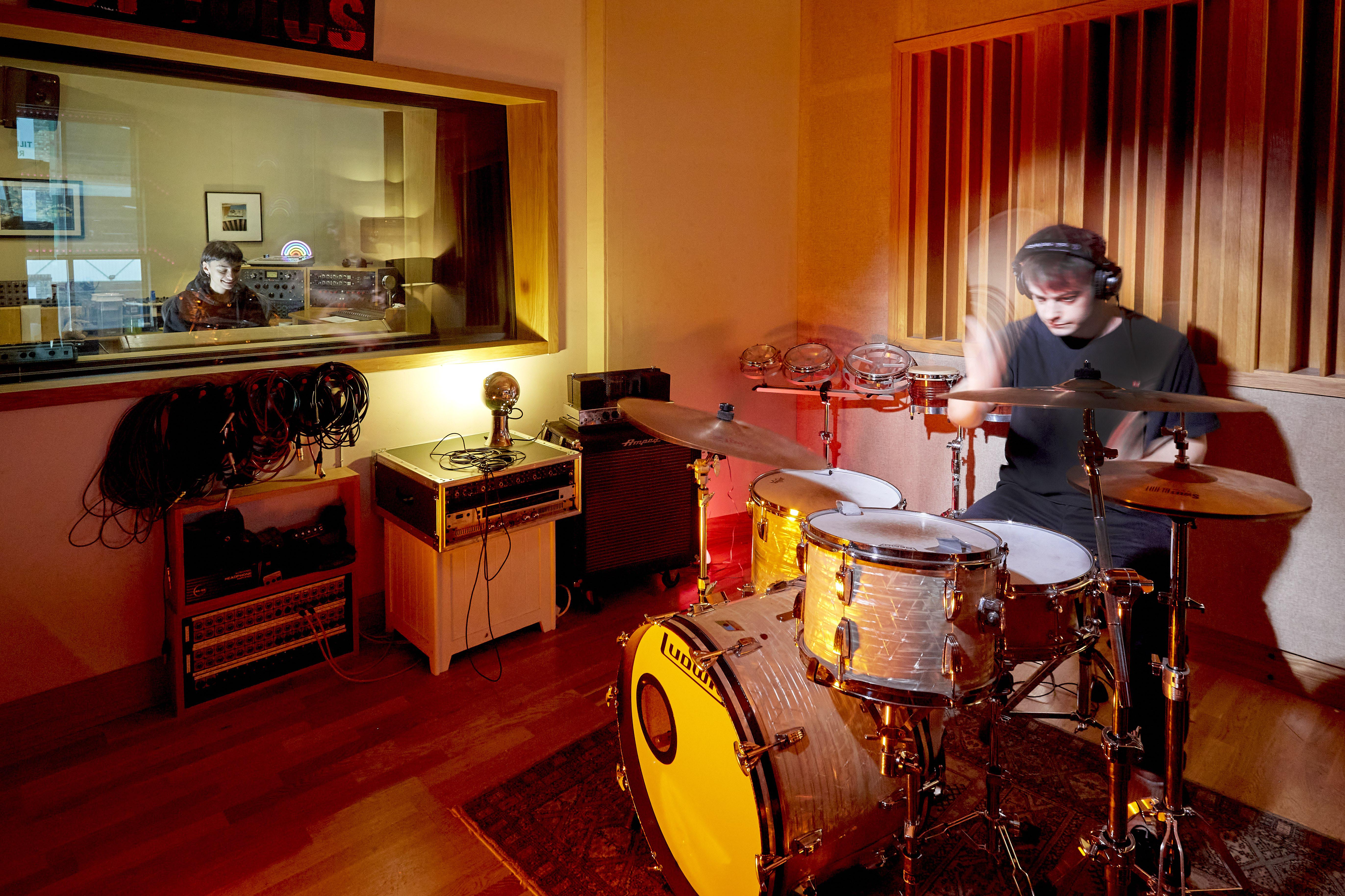 Man playing drums in a studio