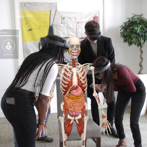 Students learning about the human skeletal system using AR