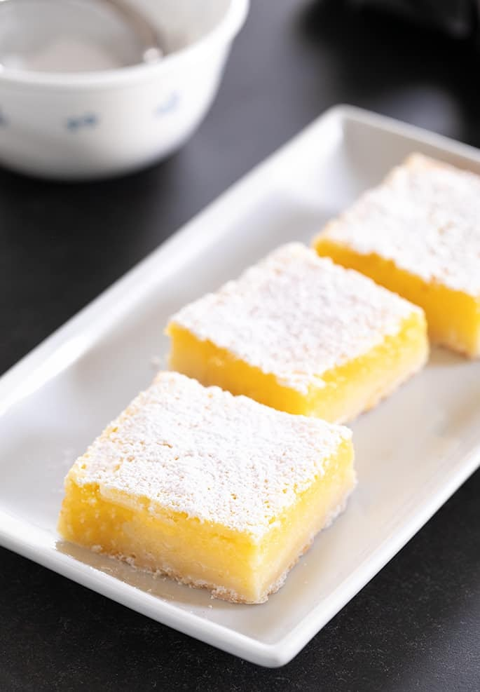 A simple lemony shortbread crust with a tart, refreshing lemon custard, these gluten free lemon bars are so easy to make.